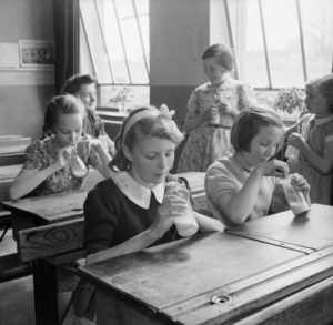 Girls_at_Baldock_County_Council_School_in_Hertfordshire_enjoy_a_drink_of_milk_during_a_break_in_the_school_day_in_1944._D20552