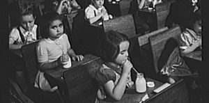 First_graders_in_public_school_having_morning_milk._8d23035v